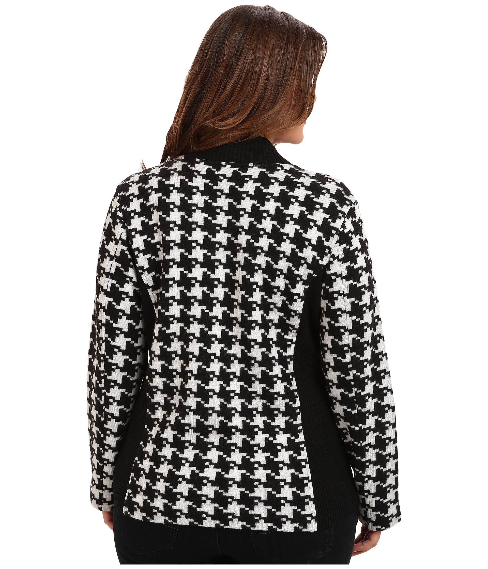 Enhance your winter wardrobe selection with this Women's Plus-Size Houndstooth Coat. It features long sleeves for sheltering out cold, nippy wind. It also has a wide collar and a double-breasted button front closure to keep you warm. This coat includes two zipper closure chest pockets for quick access to personal belongings and two side entry pockets.